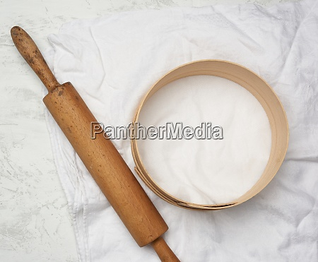 vintage wooden rolling pin and a