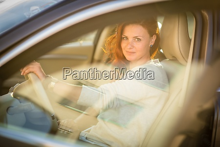 pretty young woman driving a