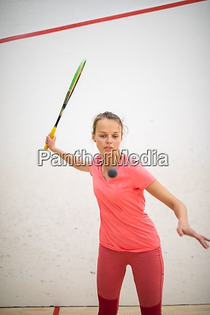 squash players in action on a