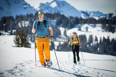 winter sports two friends hiking