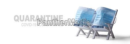 pair of beach chairs with coronavirus