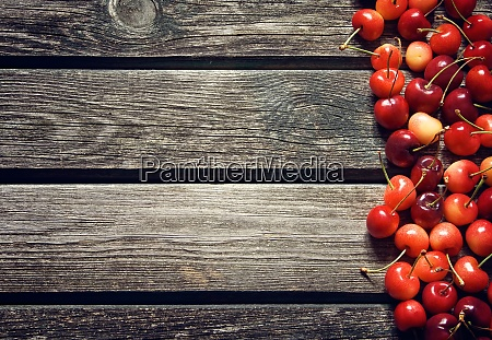 cherry on old wooden board