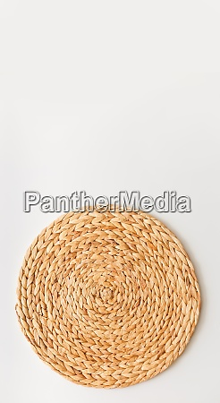 wicker straw stand isolated on white