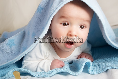 baby covered with blanket