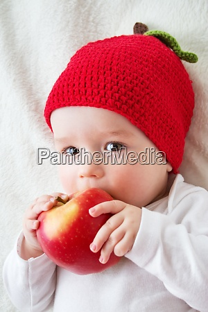 seven month old baby with apples