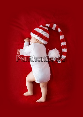 baby in red white knitted hat