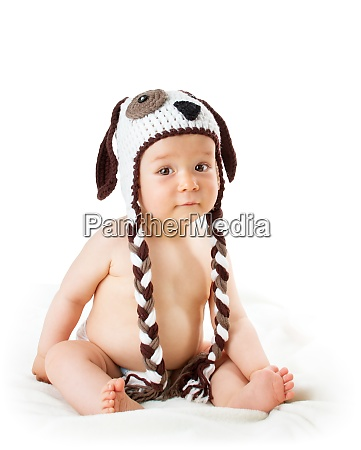 baby in dog hat isolated on