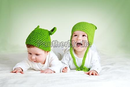 two cute babies lying in frog