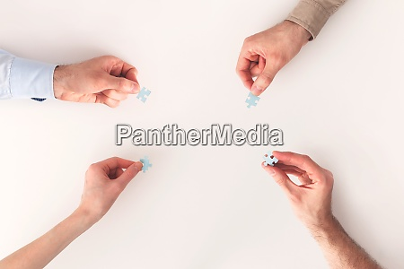 hands with puzzle items isolated on