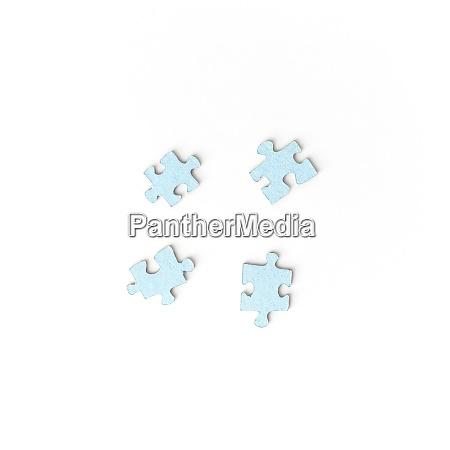 unsuitable four puzzle pieces on white