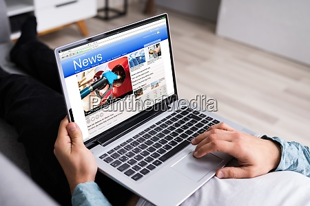 watching news on computer screen online