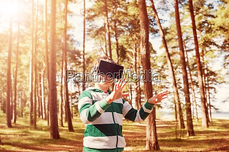 child standing in the forest in