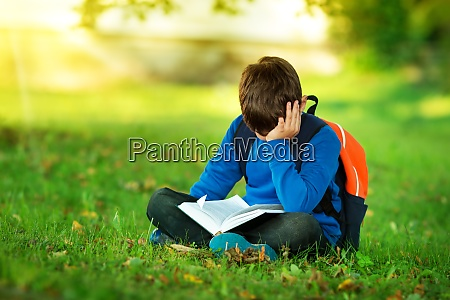 boy sitting with rucksack in the