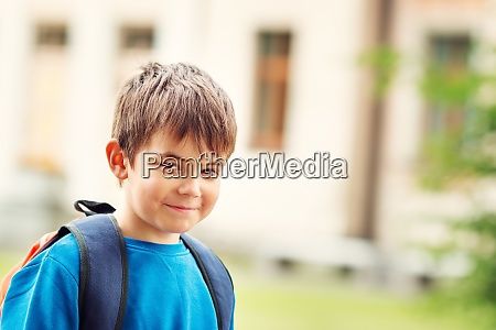 boy with rucksack infront of a