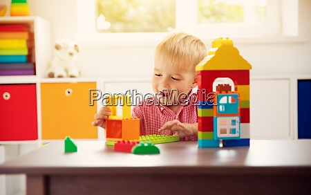 little child playing with blocks
