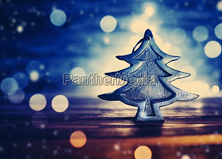 fir tree toy on wooden background