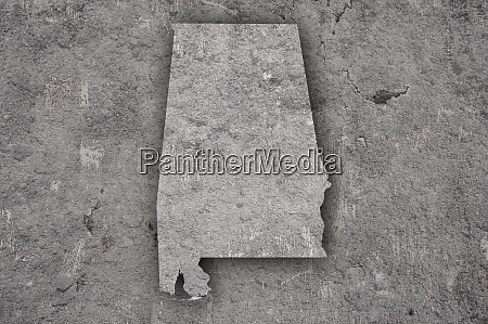 map of alabama on weathered concrete