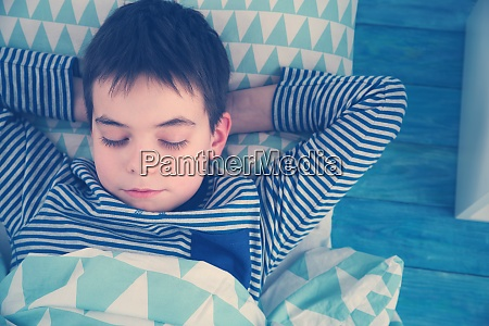 eight years old child sleeping in
