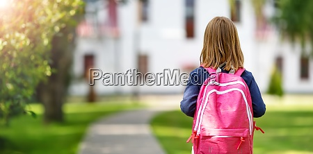 girl with rucksack infront of a