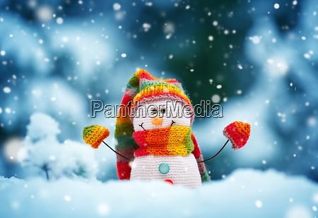 little snowman on soft snow on