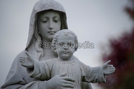 christ child cemetery stature with outstretched