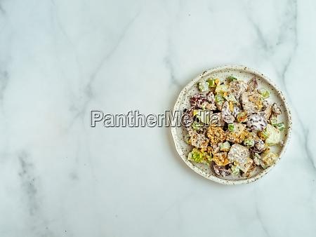 waldorf salad on white marble copy