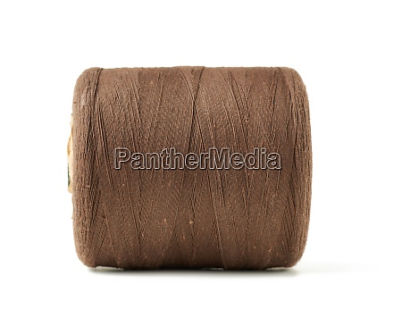 large spool with brown cotton thread