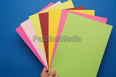 multicolored craft paper on blue background