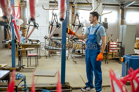 bicycle factory worker at bike assembly