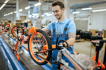 bicycle factory assembly line wheel installation