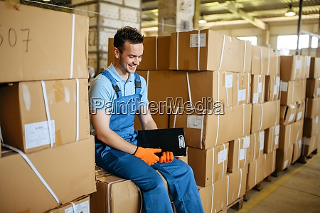 bicycle factory worker sits on boxes