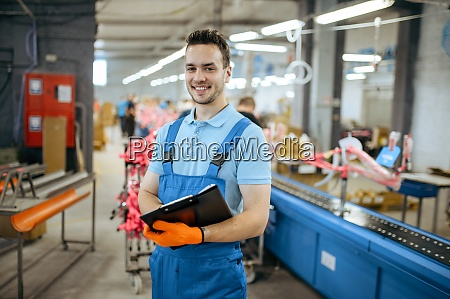 bicycle factory smiling worker at assembly