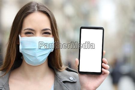 happy woman wearing mask showing blank