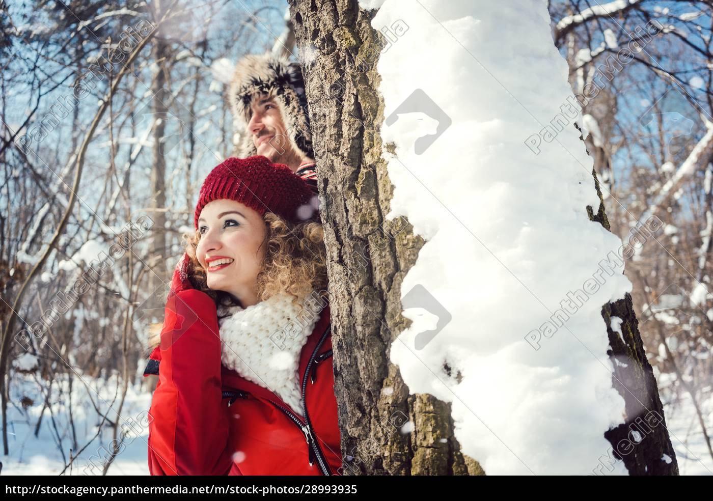 playful, couple, hiding, behind, a, tree - 28993935