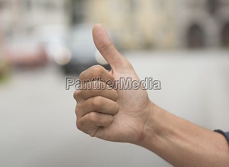 thumbs up positive hand gesture