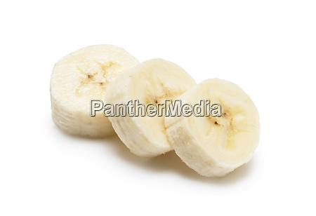 sliced bananas on a white background