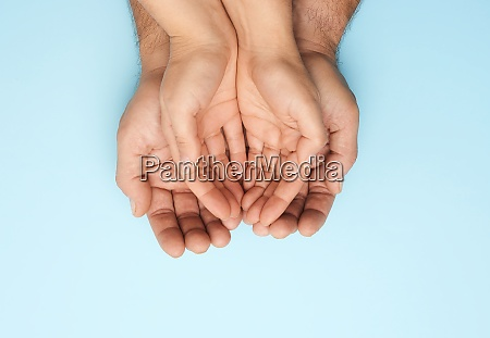 two female hands lie in male