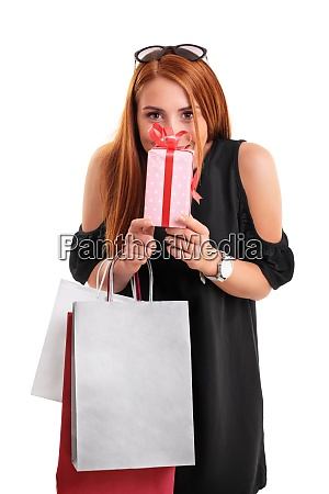 beautiful woman holding a gift and