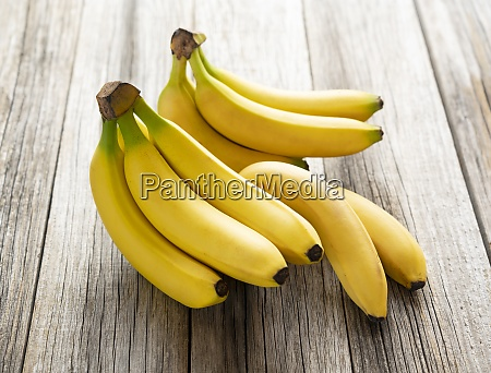 bananas on an old wooden board