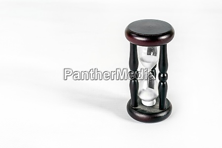 wooden hourglass on a white background