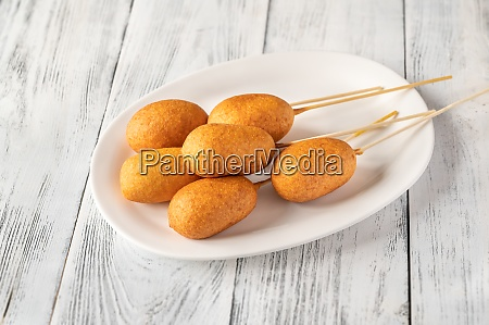 corn dogs on white serving plate