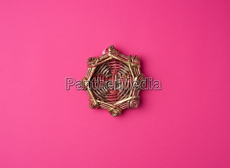wicker decorative nest on a pink