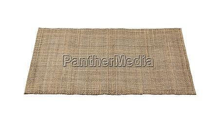 a woven luncheon mat on a