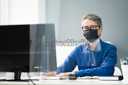 employee in office social distancing using