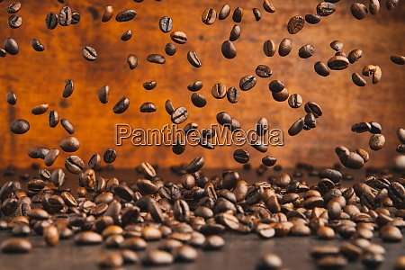 falling roasted coffee beans on table