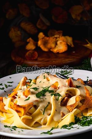 tagliatelle with fresh chanterelles in a