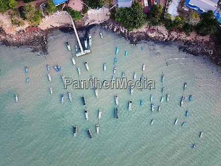 top aerial view fishing boat anchored