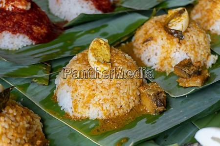 close up nasi lemak with sauce