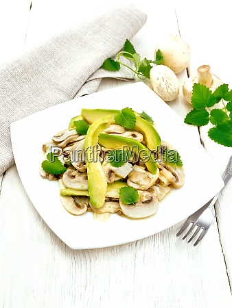 salad of avocado and champignons on