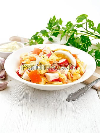 salad of surimi and tomatoes with